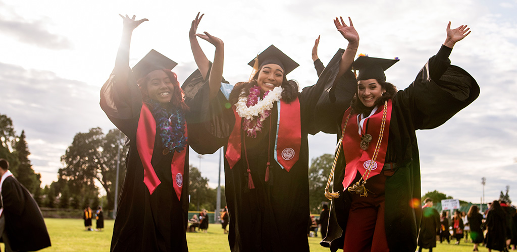 Graduate jump for joy at 2019 Commencement ceremony