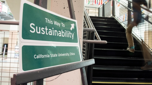 Wayfinding sign for sustainability conference at the base of stairwell