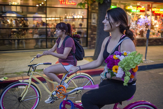 students riding bikes from farmers market